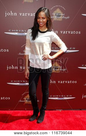 Zoe Saldana at the John Varvatos 9th Annual Stuart House Benefit Presented By Chrysler And Hasbro held at the John Varvatos Boutique, California, United States on March 11, 2012.