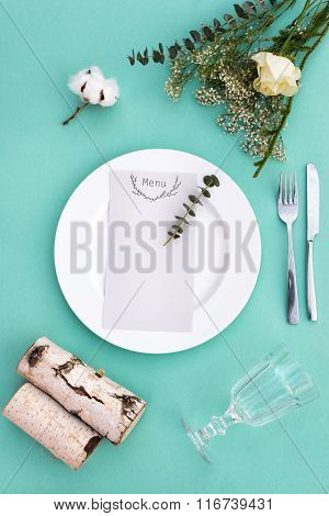 Dinner menu for a wedding or luxury evening meal. Table setting from above. Elegant empty plate, cut