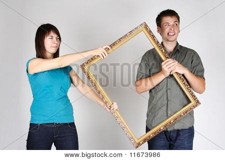 Woman Wresting Gold Decorative Frame From Man, Angry Faces