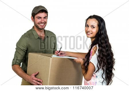 Woman signing for pack delivery with smiling postman on white screen