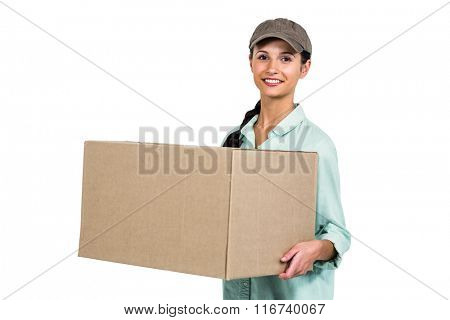 Smiling delivery woman holding pack on white background