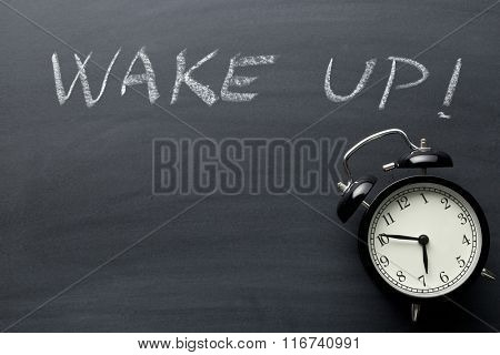Wake up. The alarm clock on blackboard.