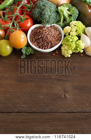 Uncooked Red Rice In A Bowl With Vegetables