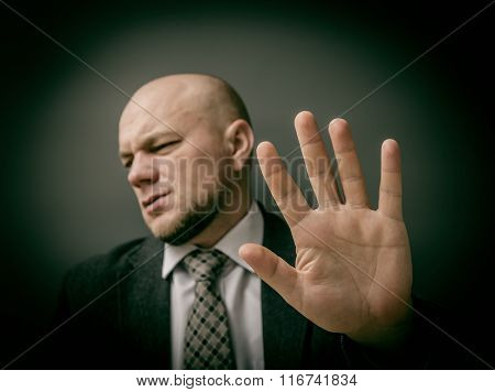 No photo! Man showing his hand as stop sign.