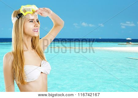 Young woman in swimsuit and diving mask on beautiful sea background