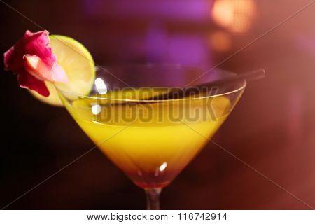 Glass of cocktail on bar closeup