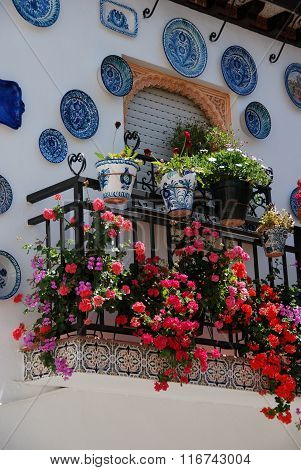 Townhouse balcony with flowers, Granada.