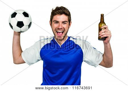 Portrait of excited man holding football and beer bottle on white screen