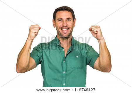 Happy man rejoicing raising fists on white screen