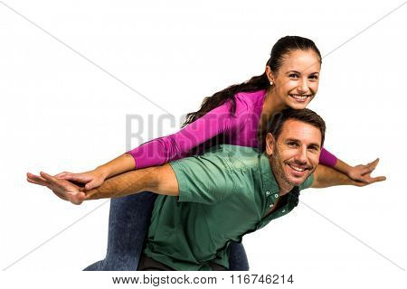Happy man giving piggy back to his girlfriend on white screen