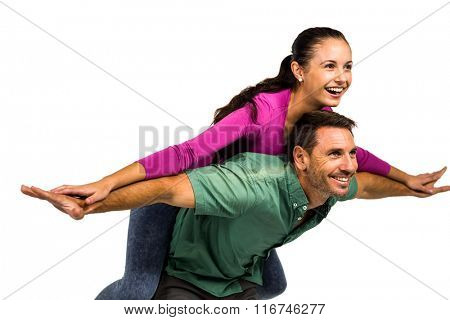 Man giving piggy back to his girlfriend on white screen