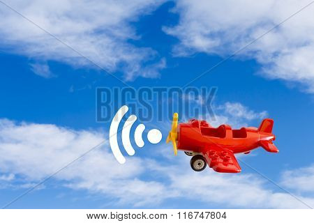 Abstract: Toy Airplane Carries Wi-fi Signal On Background Of Blue Sky