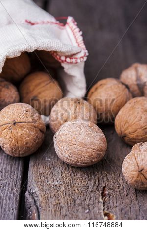 Pile Of Walnuts The Shell On A Wooden Background