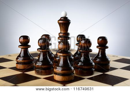 Black Queen Surrounded By Pawns
