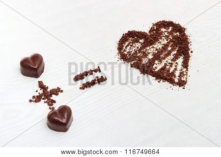 Love Formula Concept. Two Chocolate Candies Make Big Love For Chocolate