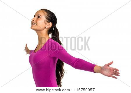 Smiling woman with arms outstretched looking up on white screen
