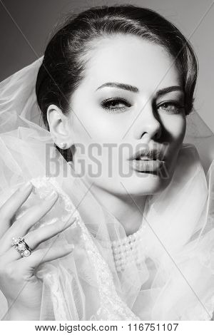 Black and white portrait of young beautiful woman with bridal veil