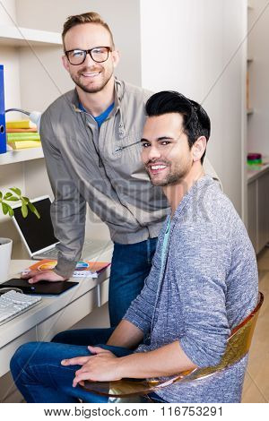 Happy gay couple smiling at home