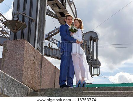 Beautiful Couple Standing On The Stone Bridge