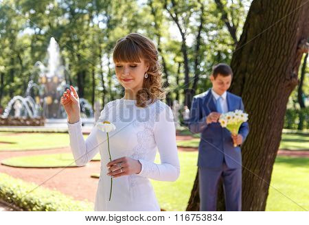 Young Bride Tears Off Chamomile Petals To Tell Fortunes