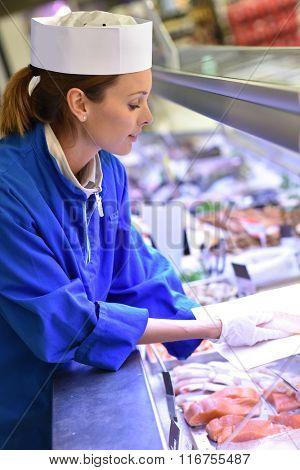 Fishmonger woman at work
