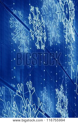 Christmas Lights Decoration On A Building Facade In Blue Tone