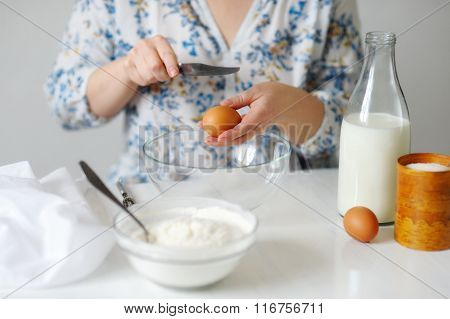 A Young Woman In A Bowl With A Broken Egg, Puts Salt.