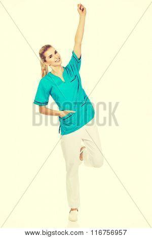 Young happy woman doctor or nurse