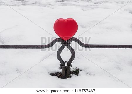 Red box heart shaped on the fence