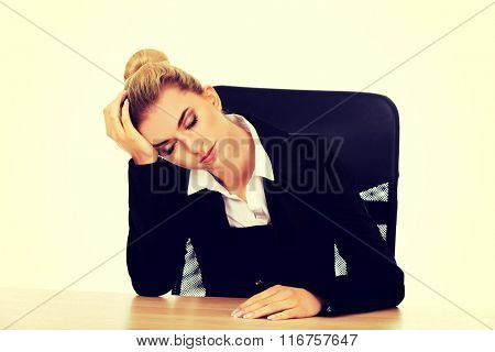 Tired young beautiful blonde businesswoman