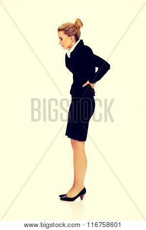 Businesswoman having huge back pain