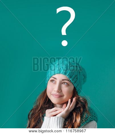 Thinking Women In Turquoise Knitted Hat With Question