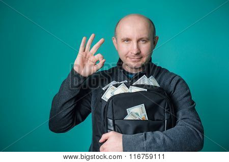 Excited Businessman Holding Bag With Money And Smiling