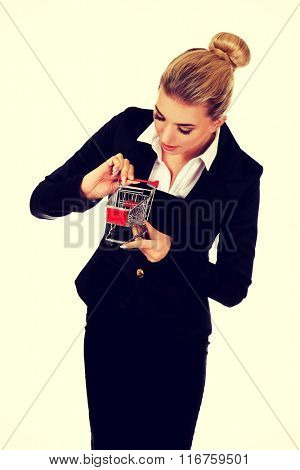 Young businesswoman with shopping trolley