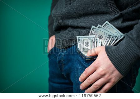 Dollars Look Out From The Pocket Of  Jeans Man