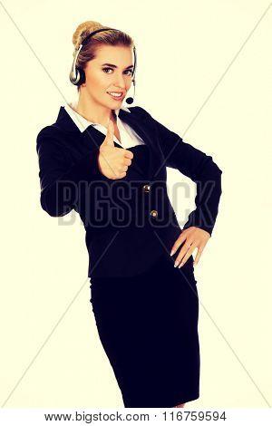 Happy businesswoman shows OK sign