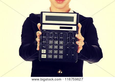 Young smile businesswoman show calculator