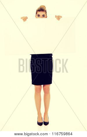 Young businesswoman with surprised eyes
