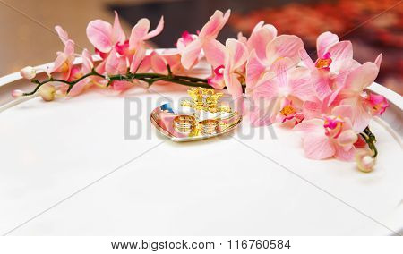 Wedding Rings On Silver Plate With Flower Diadem