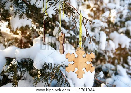 Beautiful Christmas Toy On A Snow-covered Tree In Winter