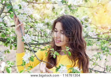 Woman In Spring Blossom. Young Naturally Beautiful Woman Near The Blooming Tree In Spring Time.