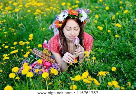 Beautiful Woman In A Red Dress Lying On Meadow With Yellow Flowers