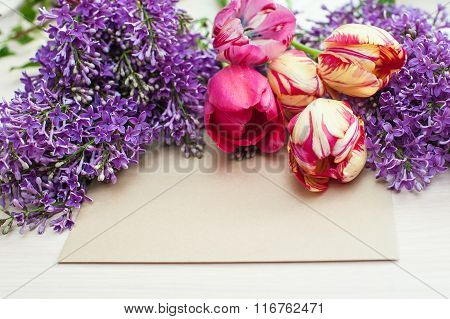Tulips And Lilac Branch Greeting Card On A Light Background