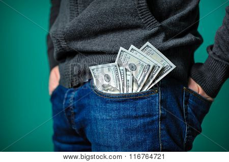 Dollar Bills Sticking Out Of The Pocket Of A Man
