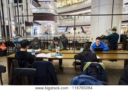 HONG KONG - JANUARY 27, 2016: interior of Starbucks cafe. Starbucks Corporation is an American global coffee company and coffeehouse chain based in Seattle, Washington
