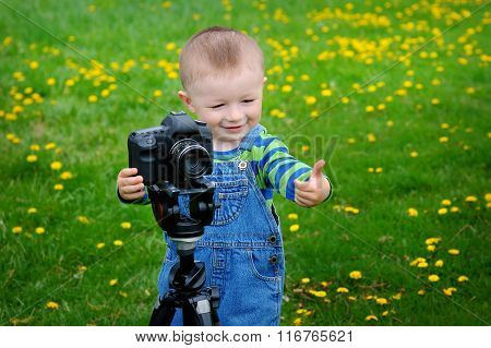 Little Boy On The Camera Shoots