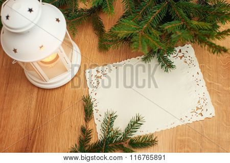 Candle And Fir Branch On The Table
