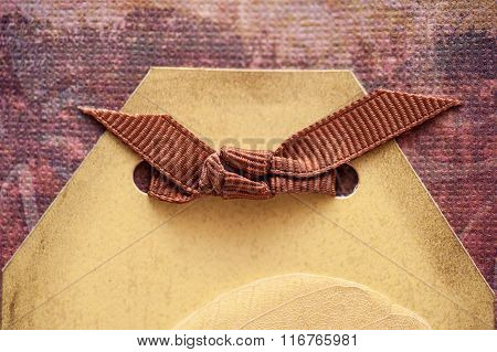 Brown Ribbon And Place For Text