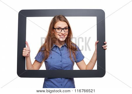 Surprised female peeping out of tablet frame