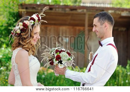 Groom Gives The Bride Wedding Bouquet